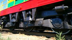 Past passes the diesel locomotive, its wheels are visible. - stock footage