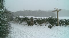 Heavy snow falling English country lane- Stock Footage