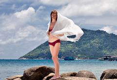 woman with white sarong - stock photo