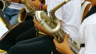Young people playing saxo in band 1 Stock Footage
