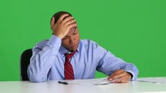 Frustrated business executive reading papers at desk Stock Footage