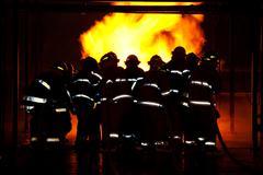 Stock Photo of fireman fighting fire