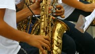 Young people playing saxo in band 3 Stock Footage