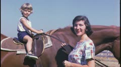 Little Girl RIDES HORSE Mother Daughter Family 1960 Vintage Film Home Movie 3692 - stock footage