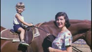 Stock Video Footage of Little Girl RIDES HORSE Mother Daughter 1960 (Vintage 8mm Film Home Movie) 3692