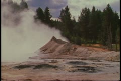 Yellowstone National Park, pools, and vapors rising, wide shot Stock Footage