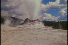 Castle Geyser, Yellowstone National Park, wide shot, tilt up Stock Footage