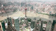 HD time lapse of buildings by Huangpu river at Pudong Skyline Shanghai, China Stock Footage