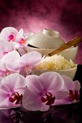 Stock Photo of asian rice dish with orchid flowers