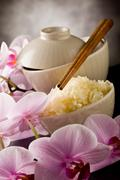 Asian rice dish with orchid flowers Stock Photos
