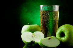 Green apple juice Stock Photos