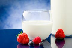 milk with berries - stock photo