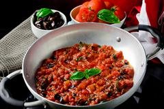 Tomato sauce with basil and olives Stock Photos