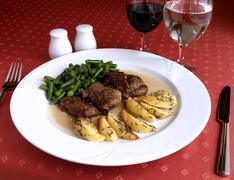 Dish of italian cuisine -   pork  in cognac sauce Stock Photos