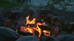 Campfire in Fire Ring by River Stock Footage
