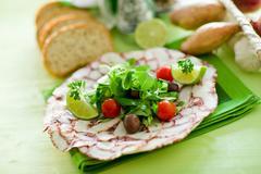 Octopus carpaccio with mixed salad Stock Photos