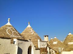typical trulli houses with conical roof in alberobello, italy - stock photo