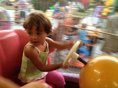 Blurred movements of a baby enjoying the merry go round Stock Photos