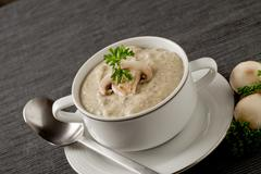 Mushroom soup with parsley Stock Photos