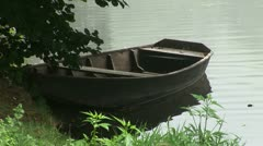 Rowing Boat under tree Stock Footage