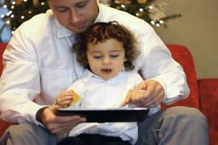Father and his little son with tablet computer Stock Footage