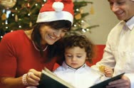 Happy family viewing photos at christmas eve Stock Footage