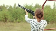 Young beautiful girl in glasses with a gun shooting2 Stock Footage