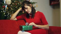 Sad woman waiting for somebody with christmas gift Stock Footage