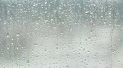 Drops of rain running down the glass Stock Footage