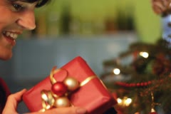 Young woman opening x-mass present - stock footage