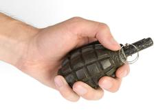 grenade in a hand - stock photo