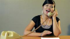 Retro young asian secretary answering the phone in vintage office - dolly shot Stock Footage