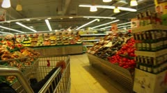 Shopping for groceries, entrance to exit supermarket, time lapse Stock Footage