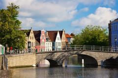 flemish houses and bridge over canal in brugge, belgium - stock photo