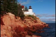 Stock Video Footage of Lighthouse on the coast of Maine, wide shot, cliffs, rocks, sea, Acadia National