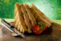 delicious sandwich on wooden table - stock photo