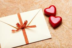 envelope with valentine card on paper background - stock photo