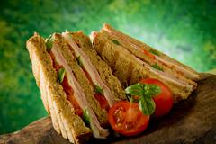 Delicious sandwich on wooden table Stock Photos