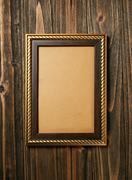 Ancient style golden photo image frame on wood background Stock Photos