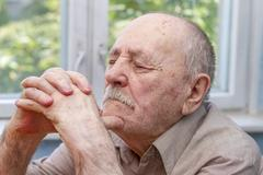 Stock Photo of senior man thinking