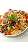 pasta with clams on white isolated background - stock photo