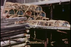 Lobster pots stacked on shore, wide shot, Bar Harbor, Maine Stock Footage