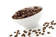 Coffee beans inside a white bowl Stock Photos