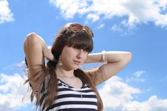 cute girl over the sky background - stock photo
