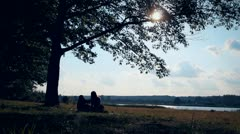 in love, boy and girl, man and woman, lovers, silhouettes,sun - stock footage