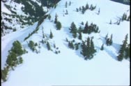 Stock Video Footage of Aerial of Mount Rainer, POV, passing snow cliffs, Mount Rainer National Park