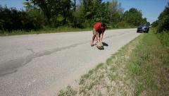 Man Helps Snapping Turtle (Chelydra serpentina) Across Road. Stock Footage