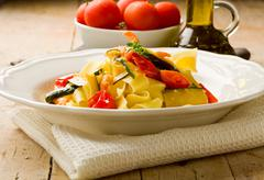Pasta with zucchini and shrimps Stock Photos