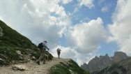 Man trekking high mountain Stock Footage