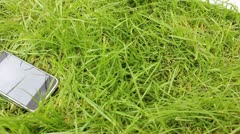 Iphone in grass Stock Footage